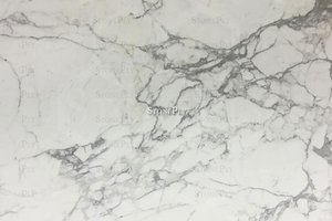 A white marble with fine grey veins.