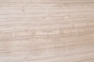 A grey and beige marble with a a veined pattern.