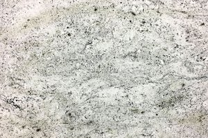 A white granite with grey and tan veining.