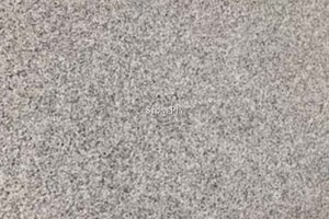 A grey, black, beige and white granite with a stippling pattern.