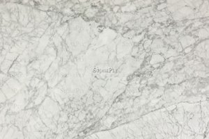 A medium-fine grained, white marble with grey veins.