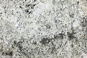 A white granite with flecks of brown and black veining.