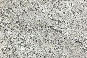 A beige granite with thin sharp flecks of black and brown.