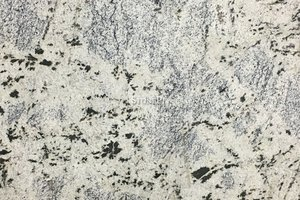 A white granite with black specks and thin veining