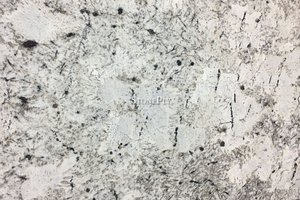 A white granite with grey and gold veins.