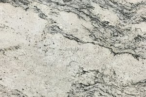 A white granite with beige variation and misty veins of grey.