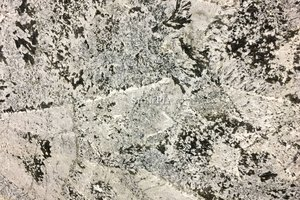 A beige granite with black veins.