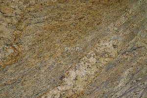 A yellow, grey and brown granite with veins.