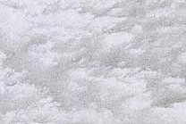 A white and grey marble with a veined texture.