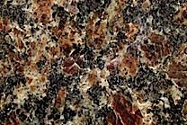 A coarse grained granite with varying shades of brown and black.
