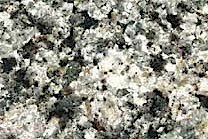 A white and grey, low variation granite that contains Amethyst Quartz.