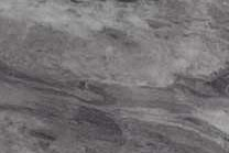A marble with both light and dark grey colors as well as white veins.