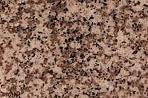 A pinkish-white granite that has a black and grey speckled pattern.