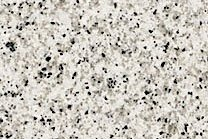 A medium grained, white granite with light grey muscovite.