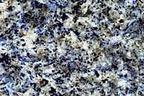 A medium grained, blue granite with white and green colors.