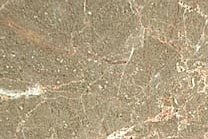A beige marble with veins of pink and white and a brownish rose background.