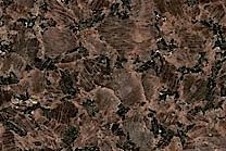 A brown granite with dark and light flecks.
