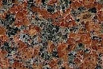 A medium grained, red granite with black and grey colors.