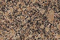 A brown granite scattered with greys, yellows, and golds.