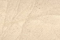 A cream colored limestone with a water texture.