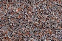 A low variation granite with red, grey, brown and black colors.