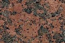 A red and black granite with a coarse texture.