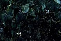 A dark green granite made of flecks of silvers and greens with undertones of white.