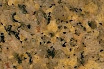 A gold and brown granite with low variation.