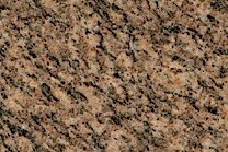 A brown and gold granite with a veined texture.
