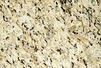 A beige granite with a cream-white background and black veins.