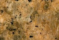 A coarse grained, golden-brown granite.