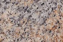 A goldish granite that has a varying color.