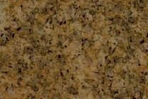A gold and brown granite with black streaks.