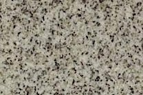 A fine grained, beige-grey granite.