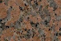 A dark red granite that has a medium texture.