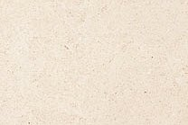 A light beige limestone with brown spots.