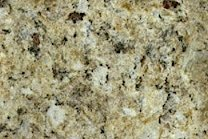 A gold and beige granite with light veins.
