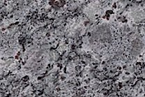 A light blue granite with some red and black.