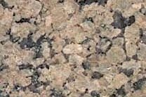 A yellow granite with a coarse texture.