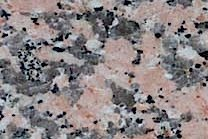 A coarse grained, pink granite with some grey and black.