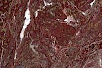 A red marble with a breccia pattern.