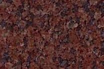 A dark red granite with dark grey to black veins.