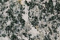 A coarse grained, white and grey granite.