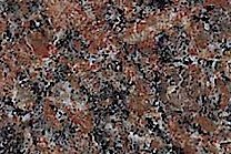 A coarse grained, red granite.