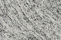 A fine grained, grey and white granite with veins.