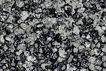 A black granite spoted with dark grey, brown and silver.