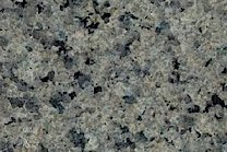 A green and grey granite with black pieces.