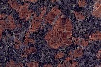 A brown and black granite with grey spots.