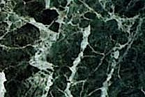 A green marble with white veins.