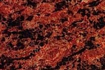 A red granite with lengthy black spots.
